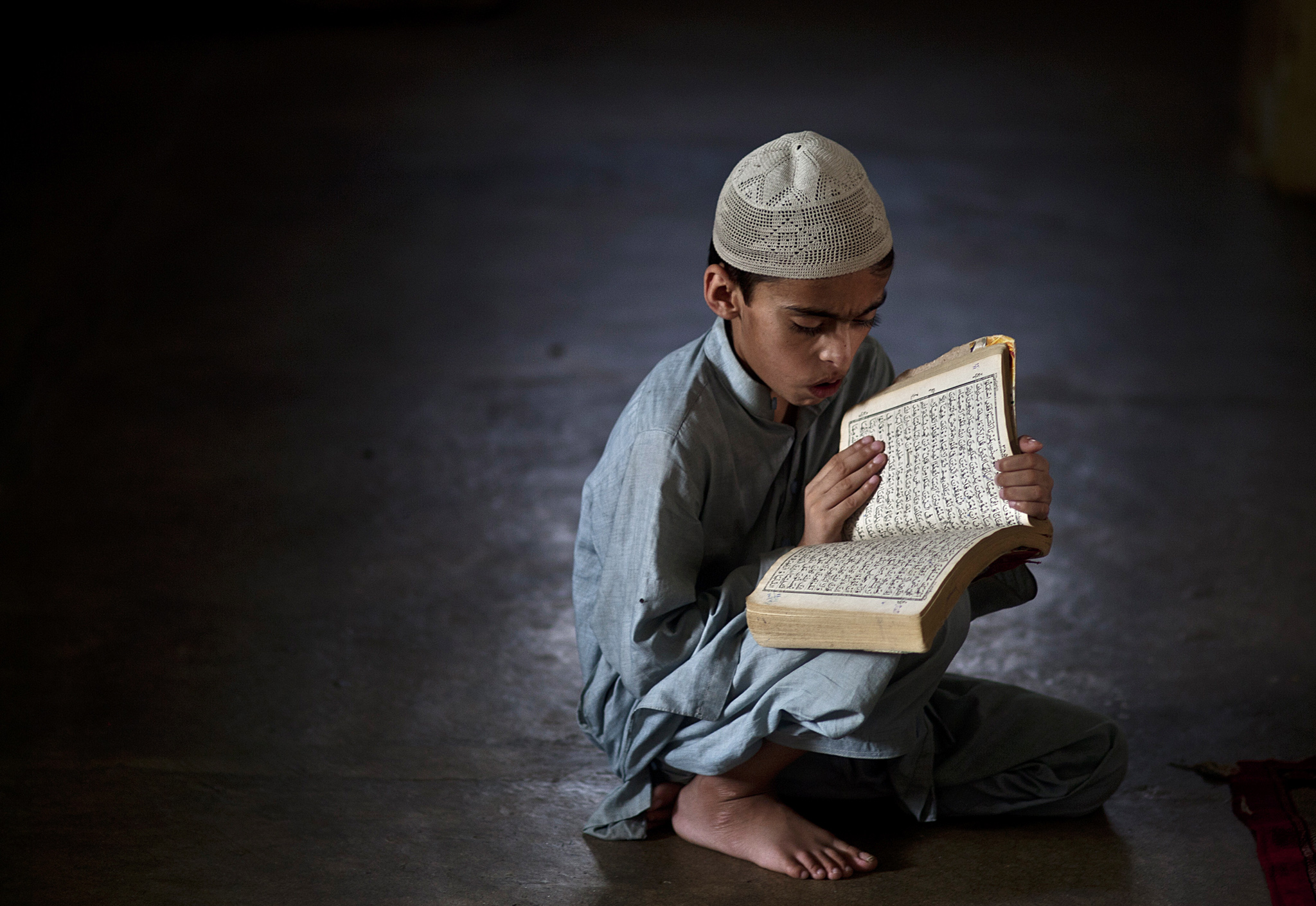 A Pakistani student reciting the Qur'an
