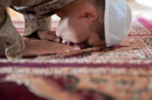 A boy is prostrating in prayer. - Ramadan